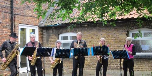 An image relating to Six on Sax at Mill Green