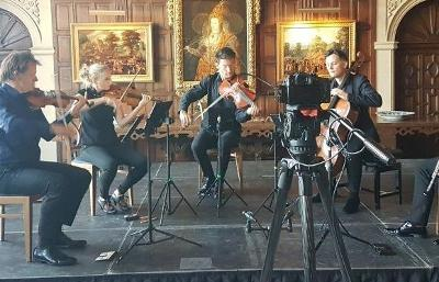 classical musicians performing in a circle