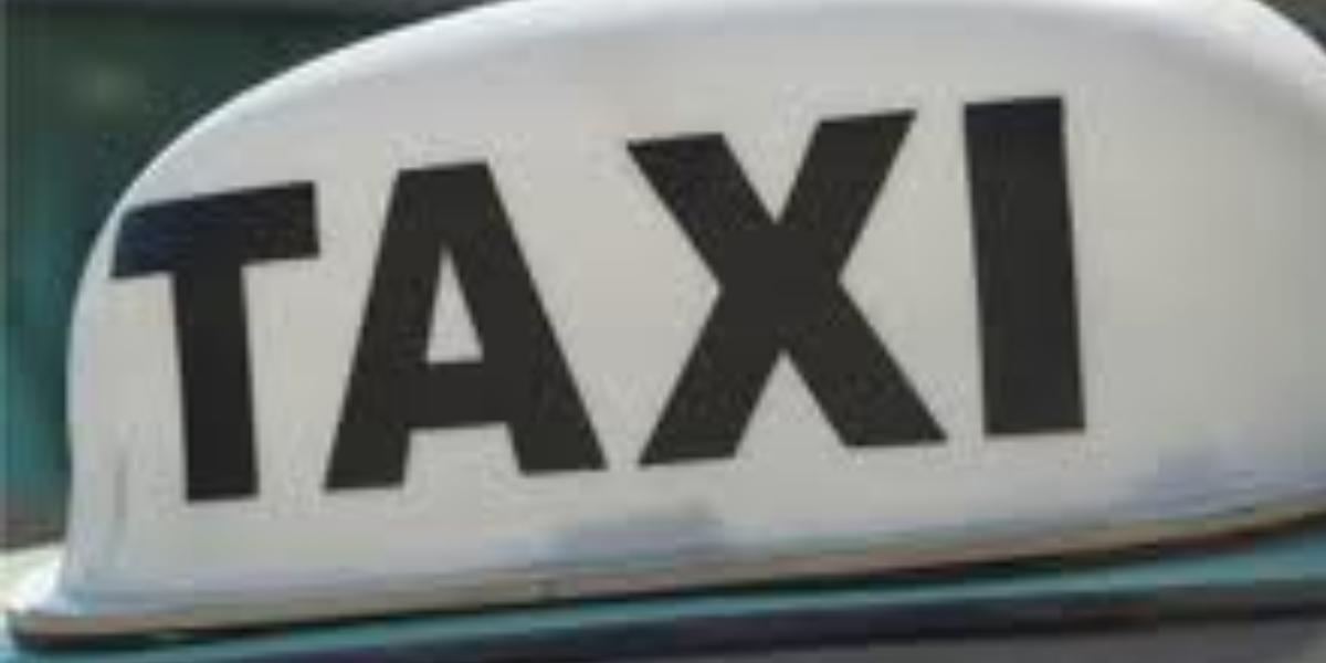 Taxi light on top of car