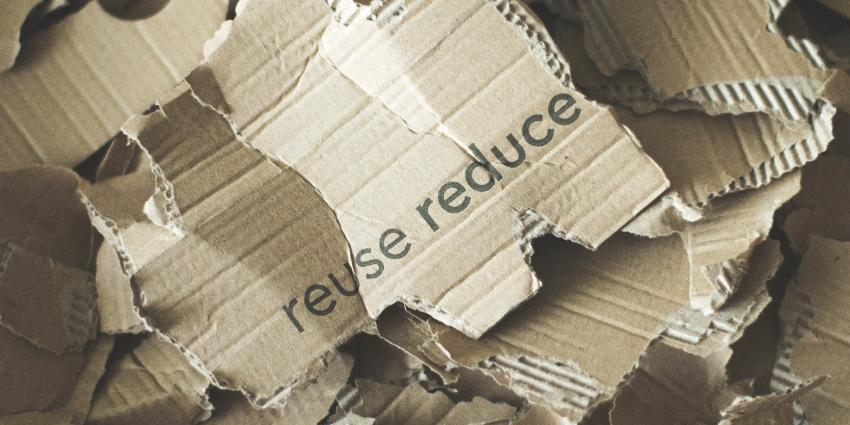 Cardboard with reduce reuse wording.